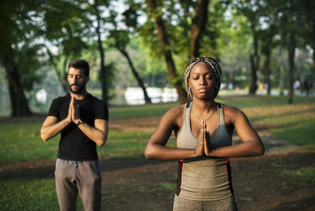 People yoga in a park