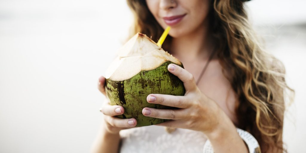 Female Drinking Coconut Beach Outdoors Concept